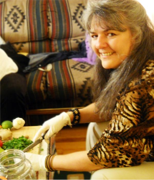 Lori chopping herbs at the table